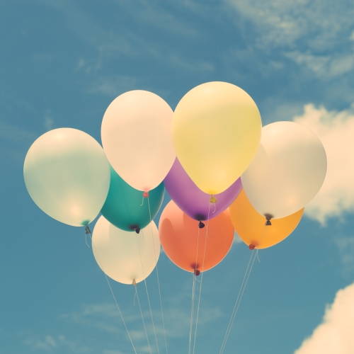 Lots of colorful balloons on the blue sky, concept of love in su